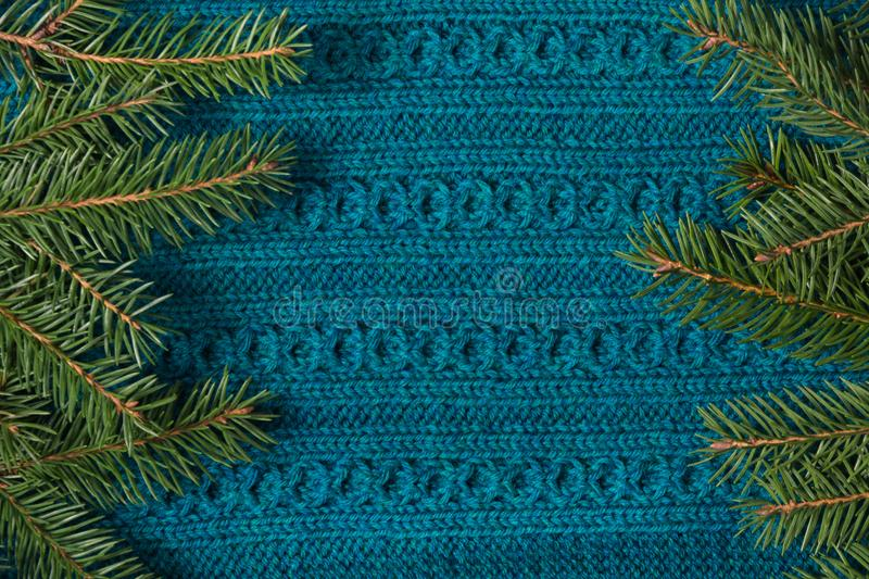 Fir tree as frame on knitted sweater background. Christmas concept. Abstract pattern. Flat lay stock photo