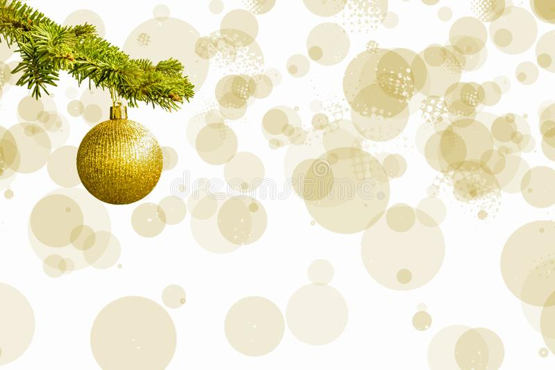 Fir tree branch with a golden glitter ball on white background. Bokeh effects. Christmastime. Christmas postcard royalty free stock images