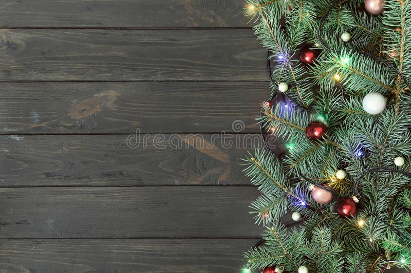 Fir tree branches with Christmas decoration on wooden background, flat lay royalty free stock image