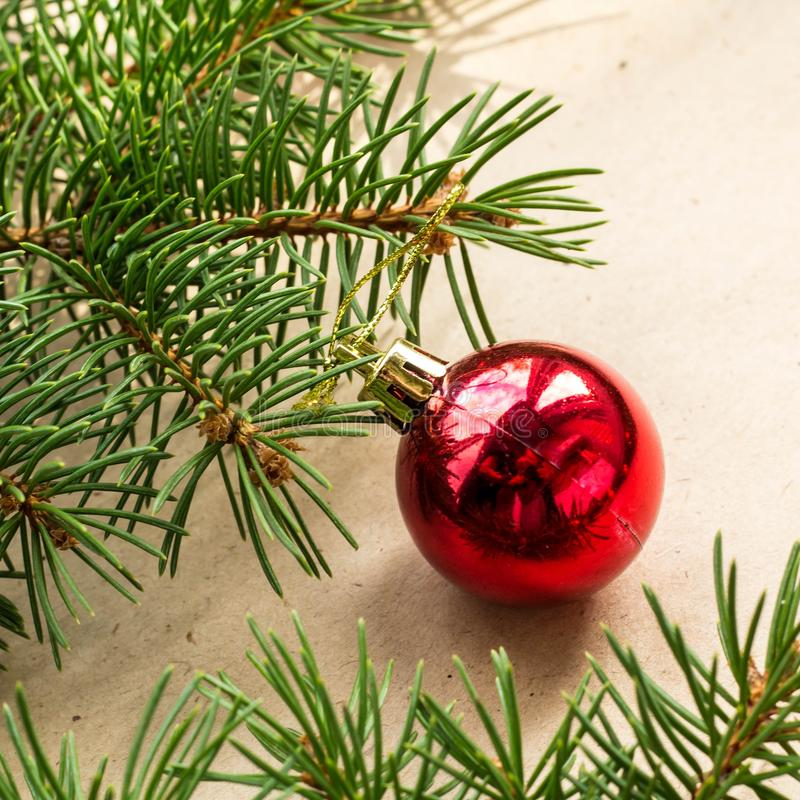 Fir tree branches decorated with red christmas balls as border on a rustic holiday background frame with copy space. Decoration, card, wood, green, new, table royalty free stock photos