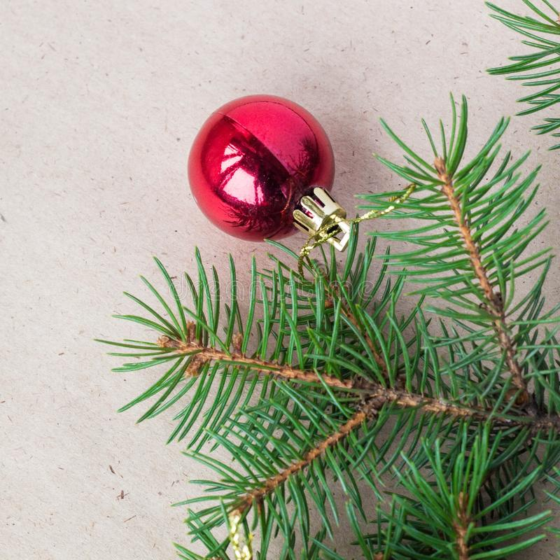 Fir tree branches decorated with red christmas balls as border on a rustic holiday background frame with copy space. Decoration, card, wood, green, new, table stock photography