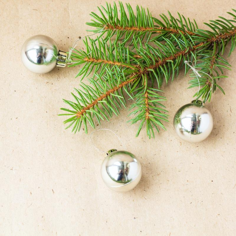 Fir tree branches decorated with silver christmas balls as border on a rustic holiday background frame with copy space. Decoration, card, wood, green, new royalty free stock images