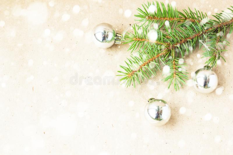 Fir tree branches decorated with silver christmas balls as border on a snow rustic holiday background frame. With copy space stock image