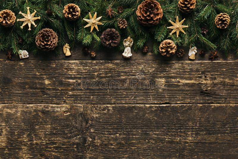 Fir Tree Branches With Pine Cones, Xmas Baubles and Decorations On Wooden Background, Festive Concept With Copy Space stock image