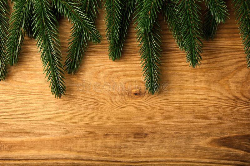 Download Fir tree branches on wood stock image. Image of season - 27149643