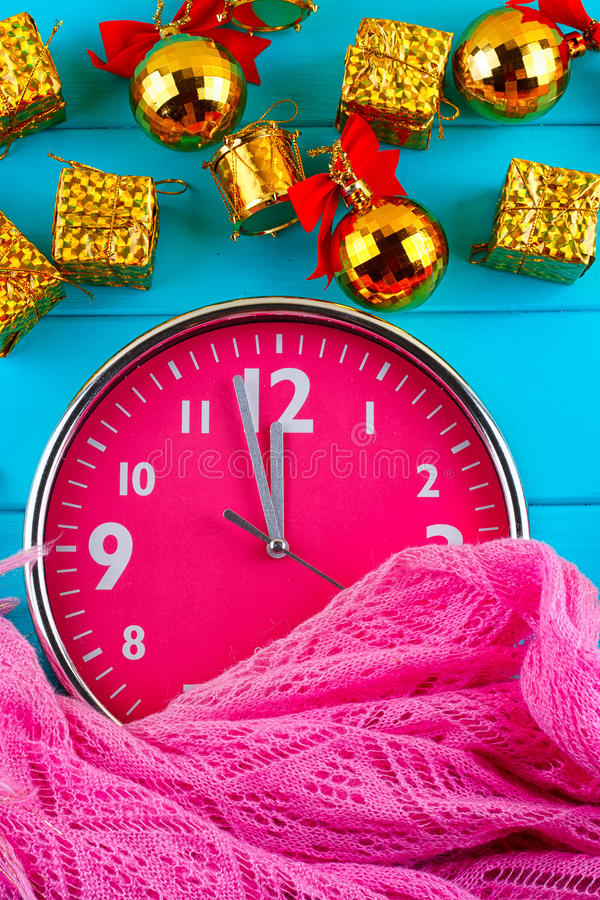 Fir tree with christmas decorations, alarm clock and gift royalty free stock photo