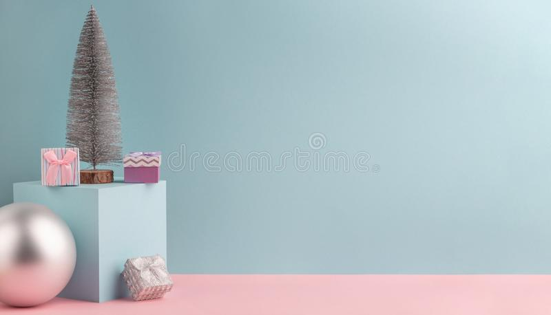 Fir tree, cube stand, silver ball and little gift boxes royalty free stock photos