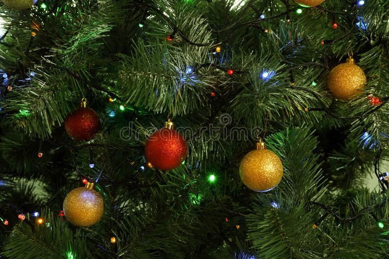 Fir tree with festive decor and glowing Christmas lights. As background royalty free stock images