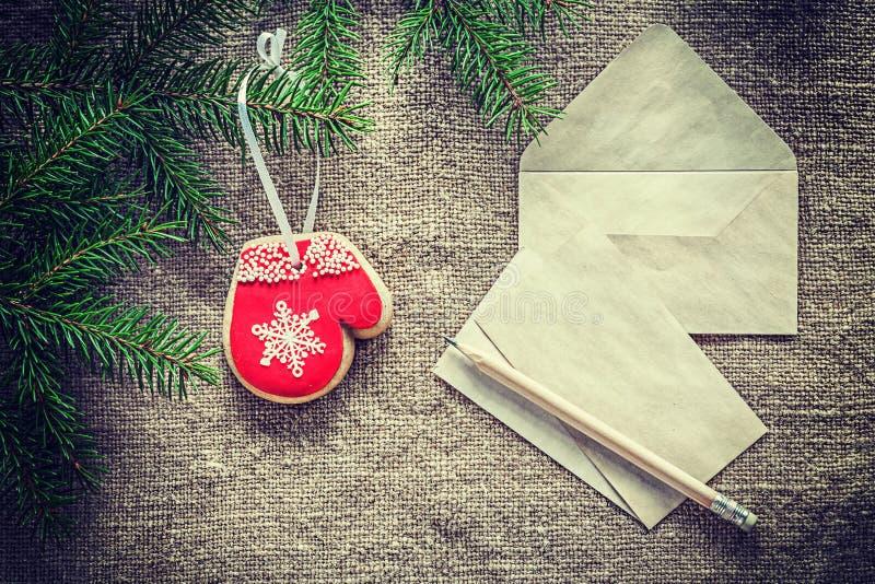 Fir tree twig envelope letter pencil gingerbread on sacking back stock images