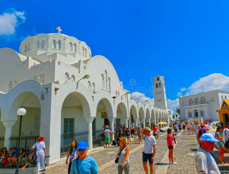 Fira, Santorini, Greece - June 10, 2015: People resting on Promenade of Fira at Santorini Greece and enjoying the view. Over the caldera on June 10, 2015 royalty free stock images