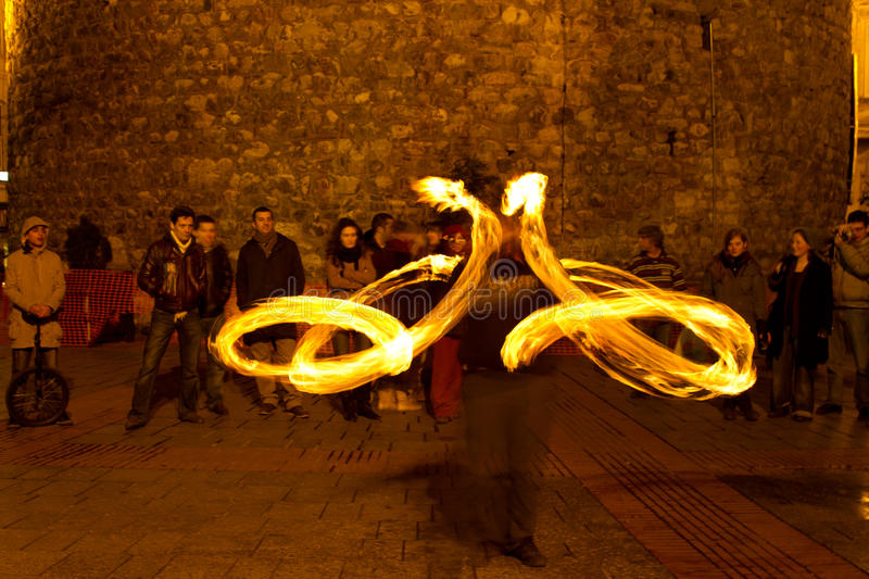 Fire. A Fire juggler performs during street shows in Galata square on February 19, 2011 in Istanbul, Turkey. Galata square is an important show place for stock images