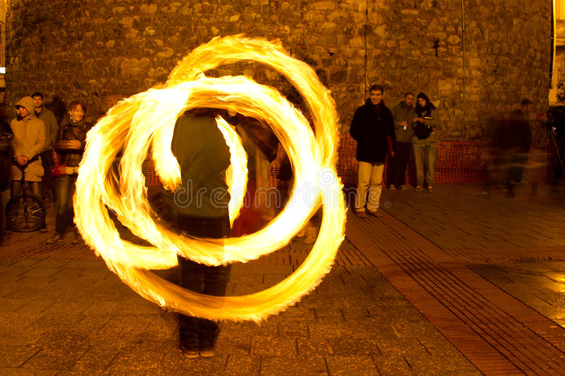Fire. A Fire juggler performs during street shows in Galata square on February 19, 2011 in Istanbul, Turkey. Galata square is an important show place for stock photo