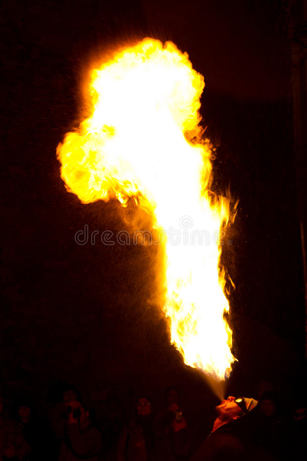 Man blowing fire editorial photo. Image of women, followers - 17802816