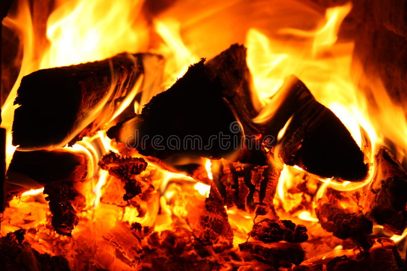 Fire. Indoor fire place with logs on fire royalty free stock image