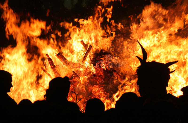 Fire. People are standing front of a huge fire royalty free stock images