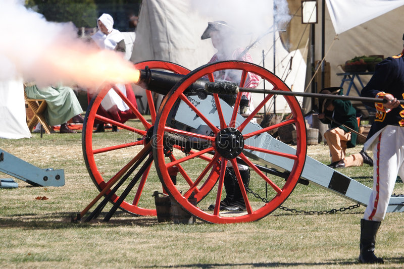 Fire!. Cannon being fired - flame from the barrel stock photos