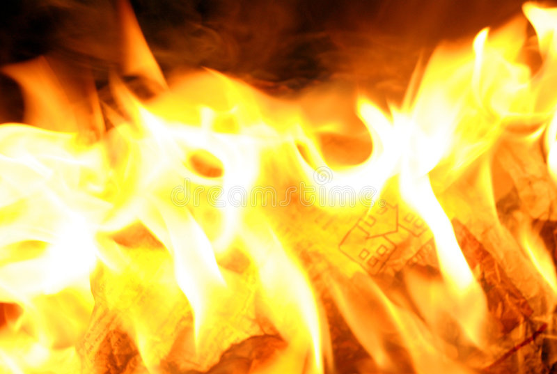 Fire. In the news paper royalty free stock photography