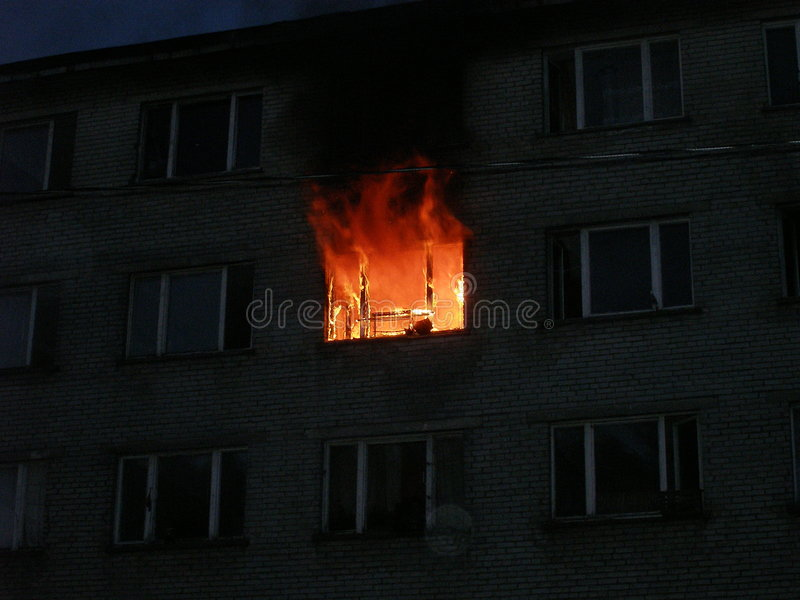 Fire accident. Flat is buring stock photography