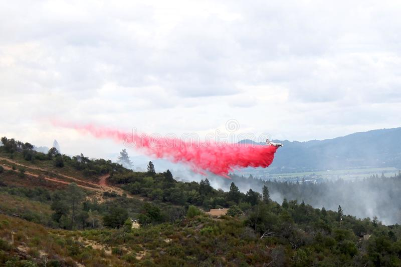 Fire air tanker in action stock photography