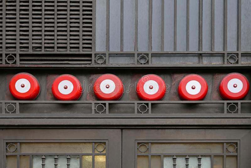 Fire alarm. Fire sprinkler alarm system at building exterior stock photos