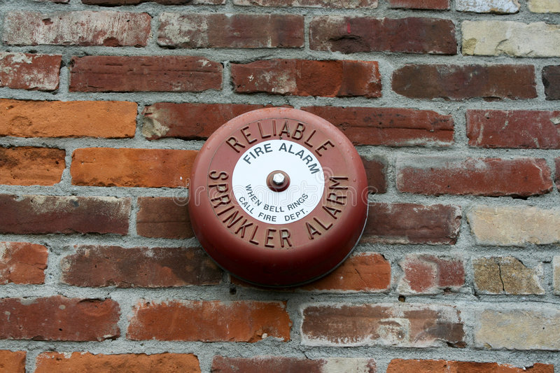 Fire Alarm. A sprinkler fire alarm on a brick wall royalty free stock photography