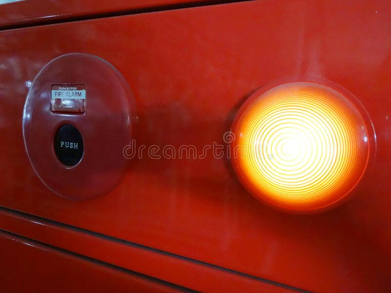 Fire alarm bottom and lighting. On a factory background royalty free stock images