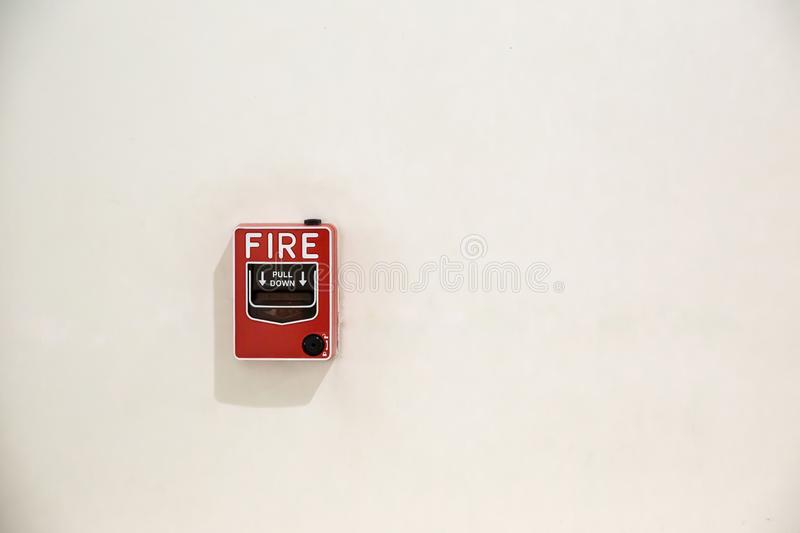 Fire alarm box on cement wall for warning and security system in the condominium place. royalty free stock photography