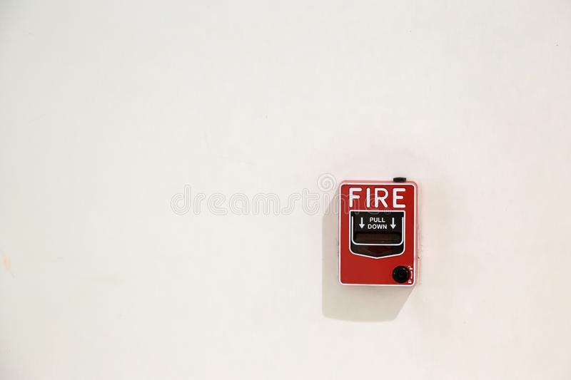 Fire alarm box on cement wall for warning and security system in the condominium place. Standard safety in the resident, shopping mall and public place concept royalty free stock image