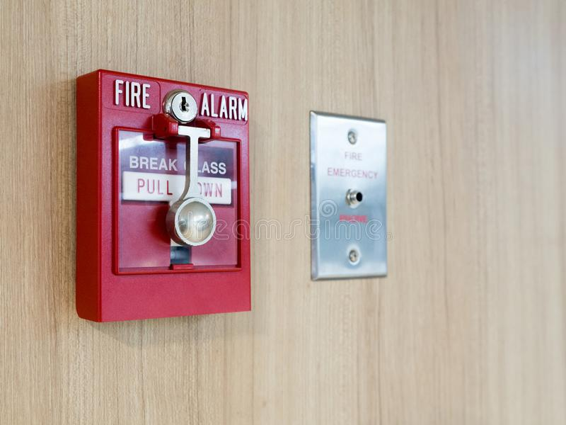 Fire alarm box with fire fighters telephone on wall for warning and security system royalty free stock photography