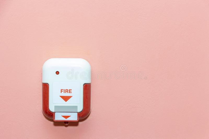 Fire alarm box on pink wall for alarm and security system stock images