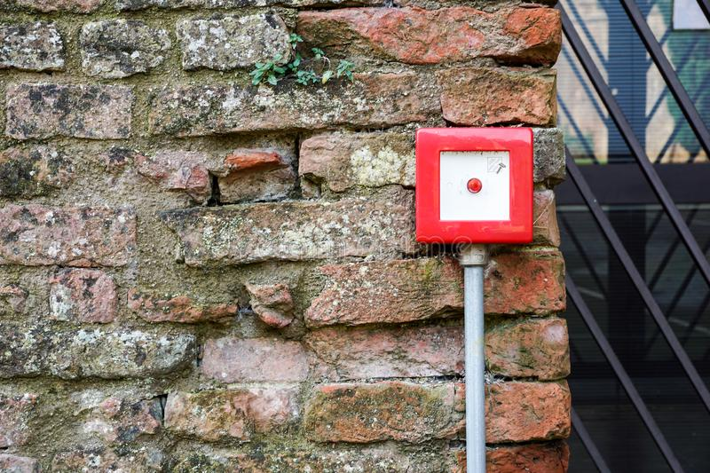 Fire alarm box on white cement wall for security warning alert, push button fire alarm in the building,  fire royalty free stock image