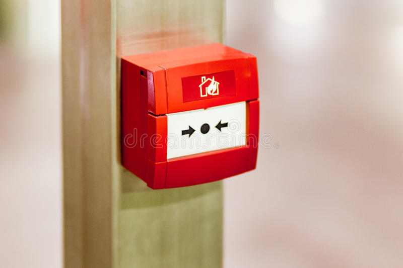 Fire alarm button. Generic fire alarm button, red indicates a concept of urgent distress call for a serious imminent danger stock image