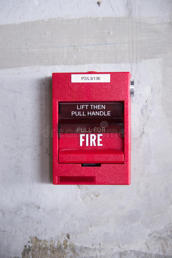 Fire alarm. Colse up of a fire alarm equipment installed on grunge wall royalty free stock photos