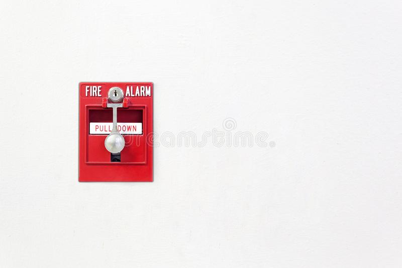 Fire alarm. Fire break glass alarm switch on the white wall. Security system red fire alarm box. royalty free stock photos