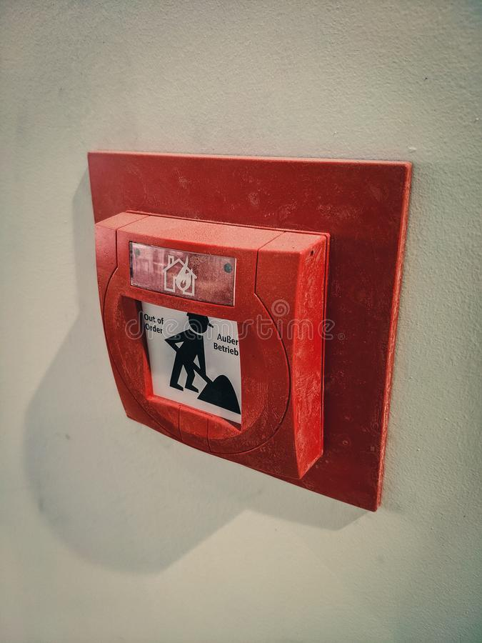 Fire alarm pushbutton in office building stock image