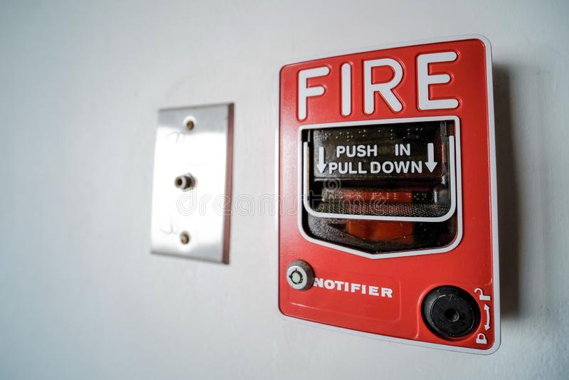 Fire alarm. Red fire alarm alert button in the building security emergency safety system warning danger push break rescue sign box industrial equipment wall stock photo