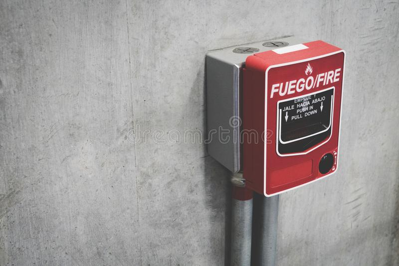 Fire alarm switch on the concrete wall in building for safety with copy space for text. Close-up of fire alarm machine royalty free stock images