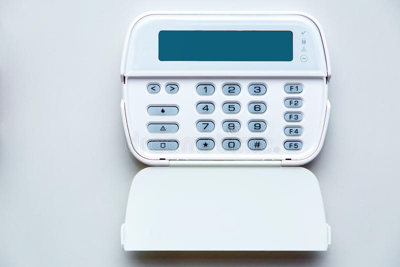 Fire Alarm System Control Center. Fire Alarm System Control Center with an open lid for entering a security password and mode settings, front view of a device royalty free stock image