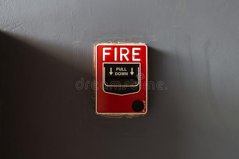 Fire alarm system on the grunge grey wall. Fire alarm system on the grunge grey wall royalty free stock image