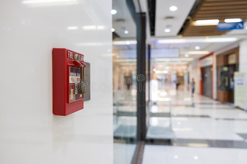 Fire alarm on the wall of shopping mall warning and security system stock images
