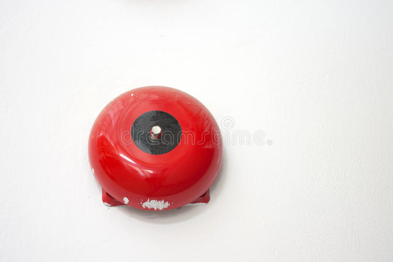 Fire alarm. On white wall background stock image
