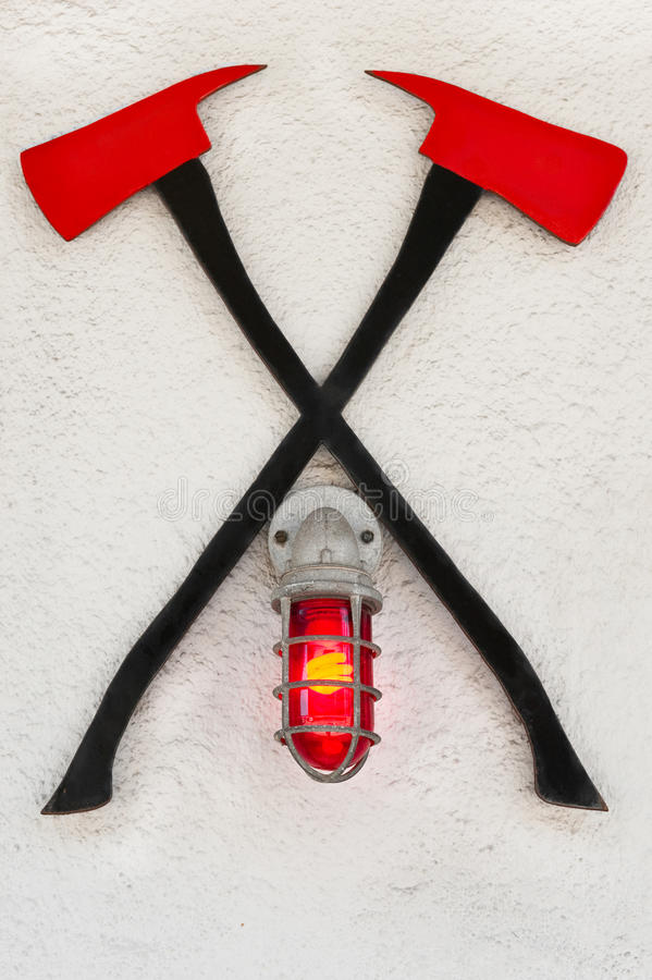Fire Axes. Crossed fire axes hanging in front of a fire station stock photos
