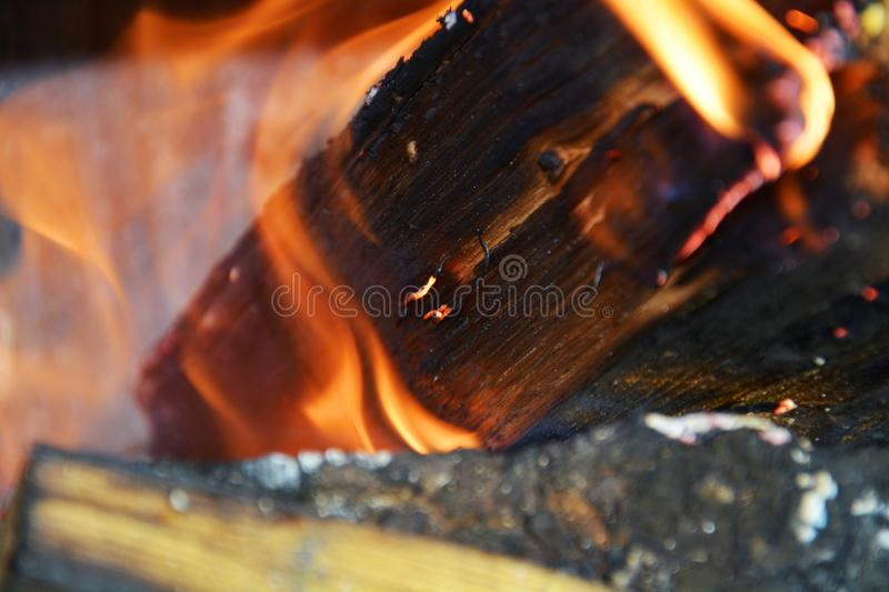 Fire. Wooden logs burning, flames and hot temperature stock photo