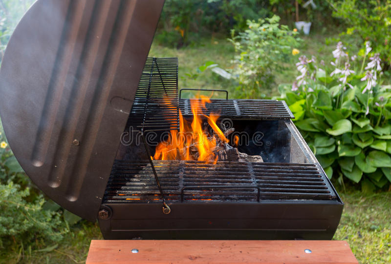 Fire in barbecue grill stock photo