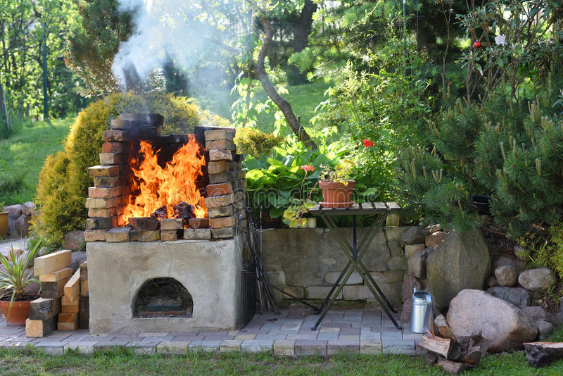 Fire in barbecue grill stock photos