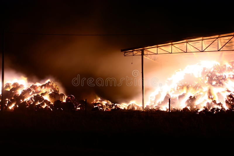 Fire in the barn stock images