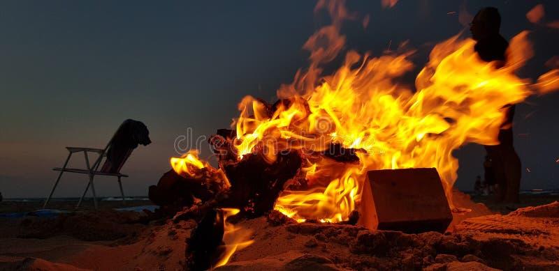 Fire on the beach stock photos