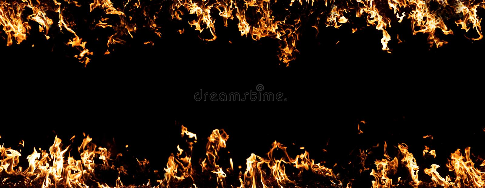 Fire on black background, abstract background with copy space in the center, banner format.  royalty free stock photography