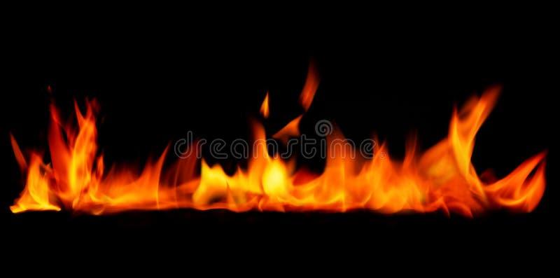 Fire border on black background. Orange flaming fire isolated on black background royalty free stock photo