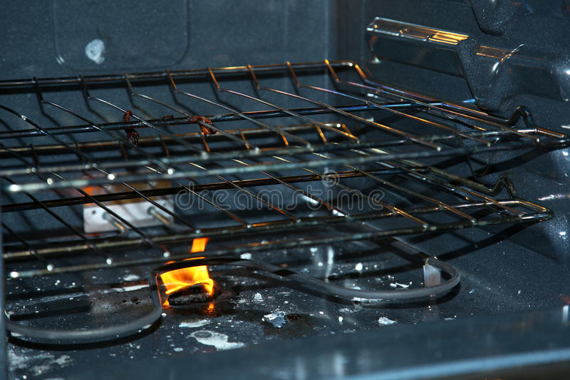 Fire In Bottom Of Oven Stock Photography